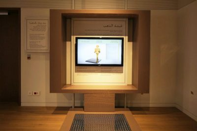 museum exhibit with interactive scale